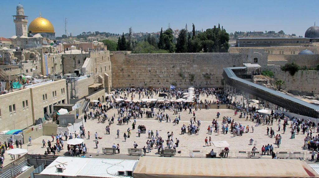 The Wailing wall with people in prayer - City of Peace