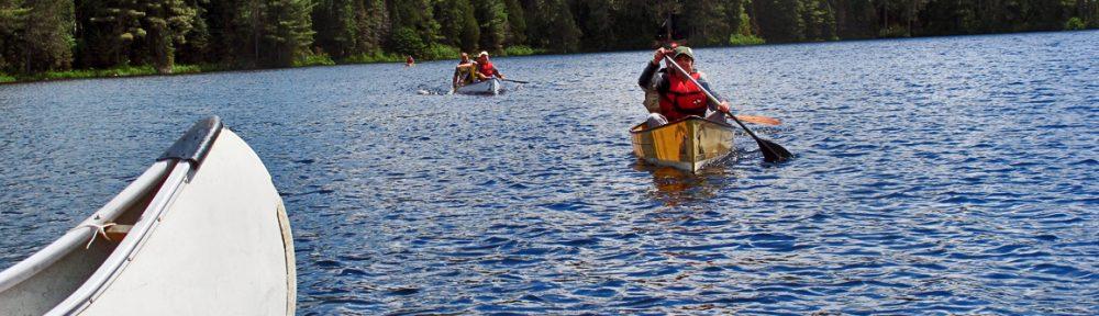 Canoe-Canada's Transportation - two canoes paddling toward me in Algonquin lake