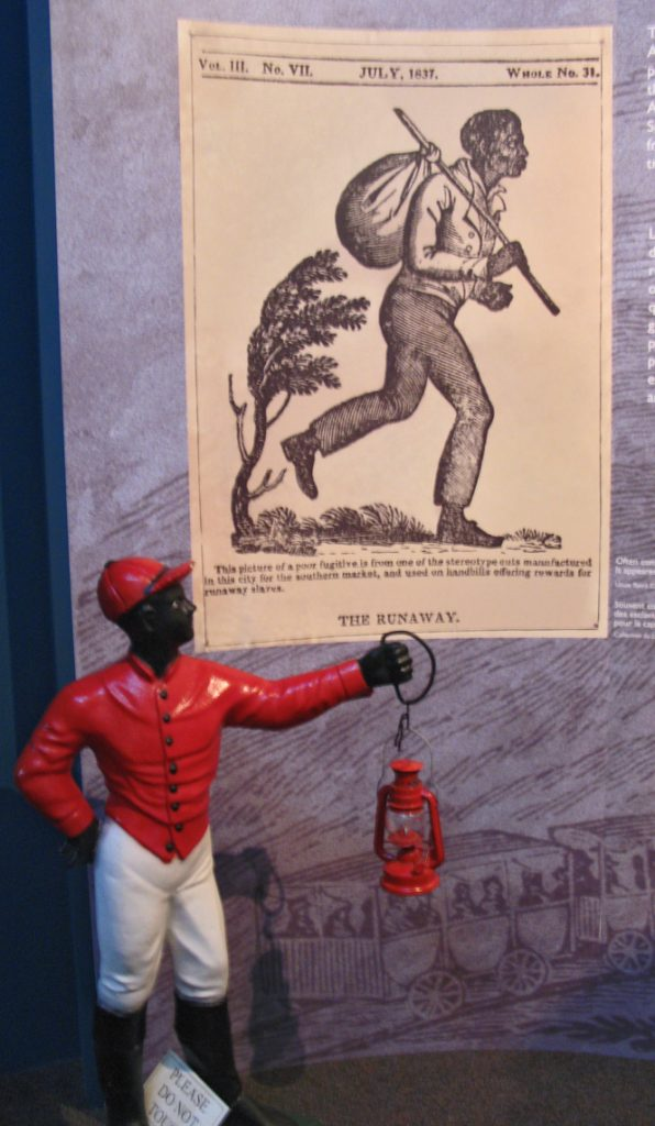 Black lawn ornament and slave poster - a poignant contrast