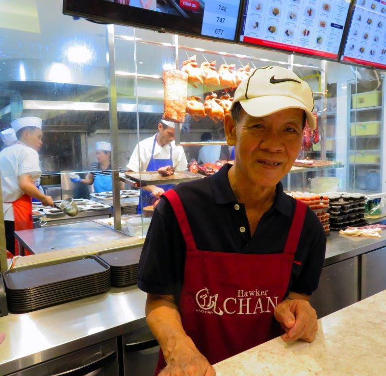 Hawker Chan poses in his restaurant in Singapore-Dining capital of Asia