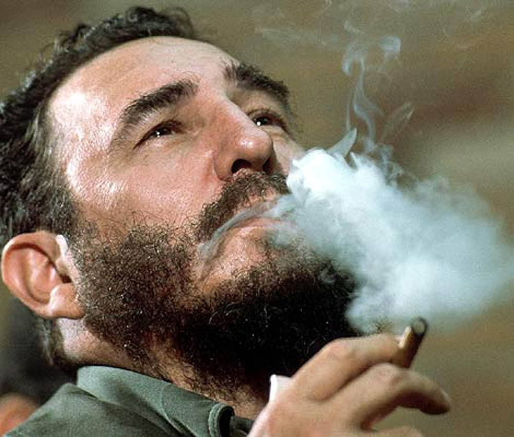 Fidel Castro blowing smoke from a cigar - The Perfect Cigar -Cuba's Gift to the World