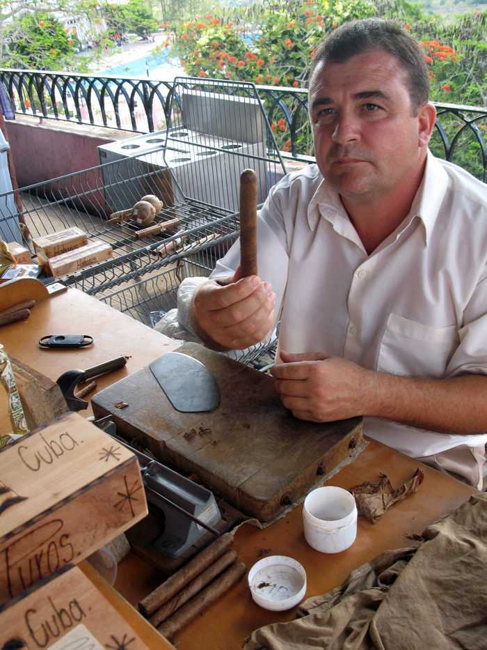 man holding hand-rolled cigar - The Perfect Cigar -Cuba's Gift to the World