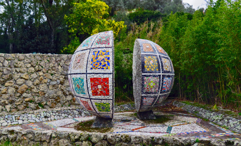 A globe split in two andcovered in colourful ceramic tiles
