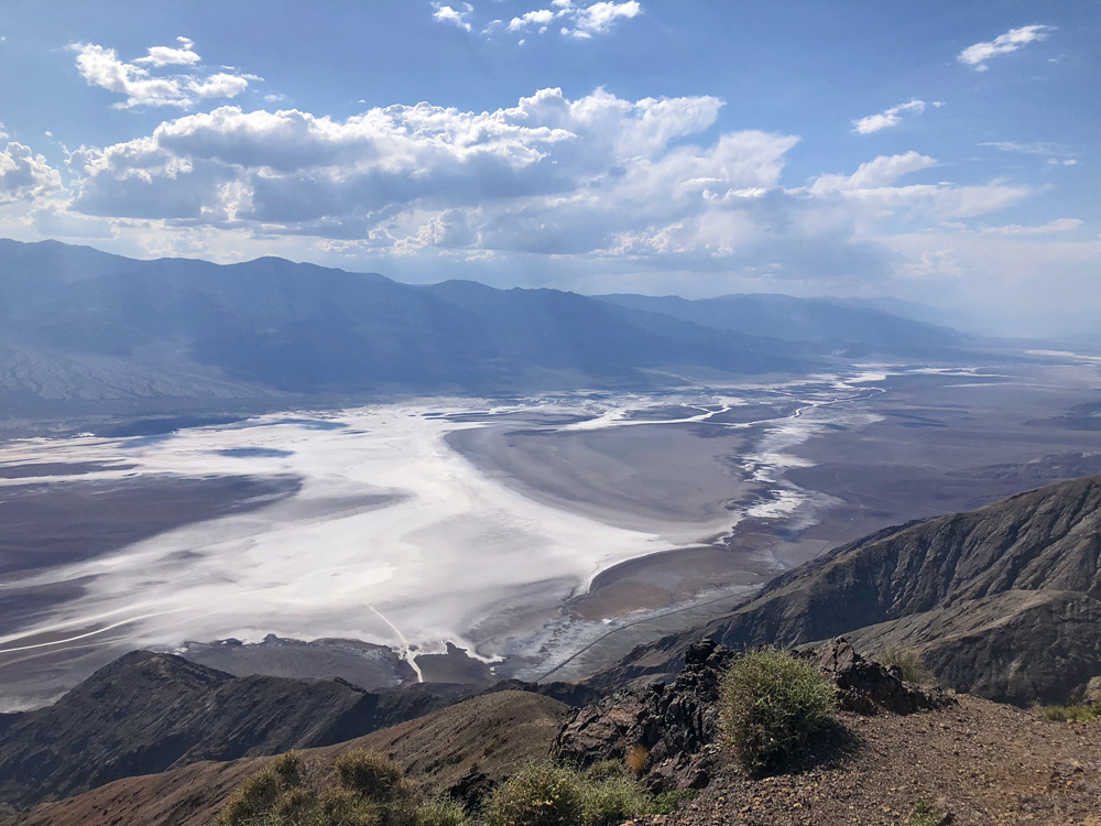 View of a valley with white salt fields extended into the distance.