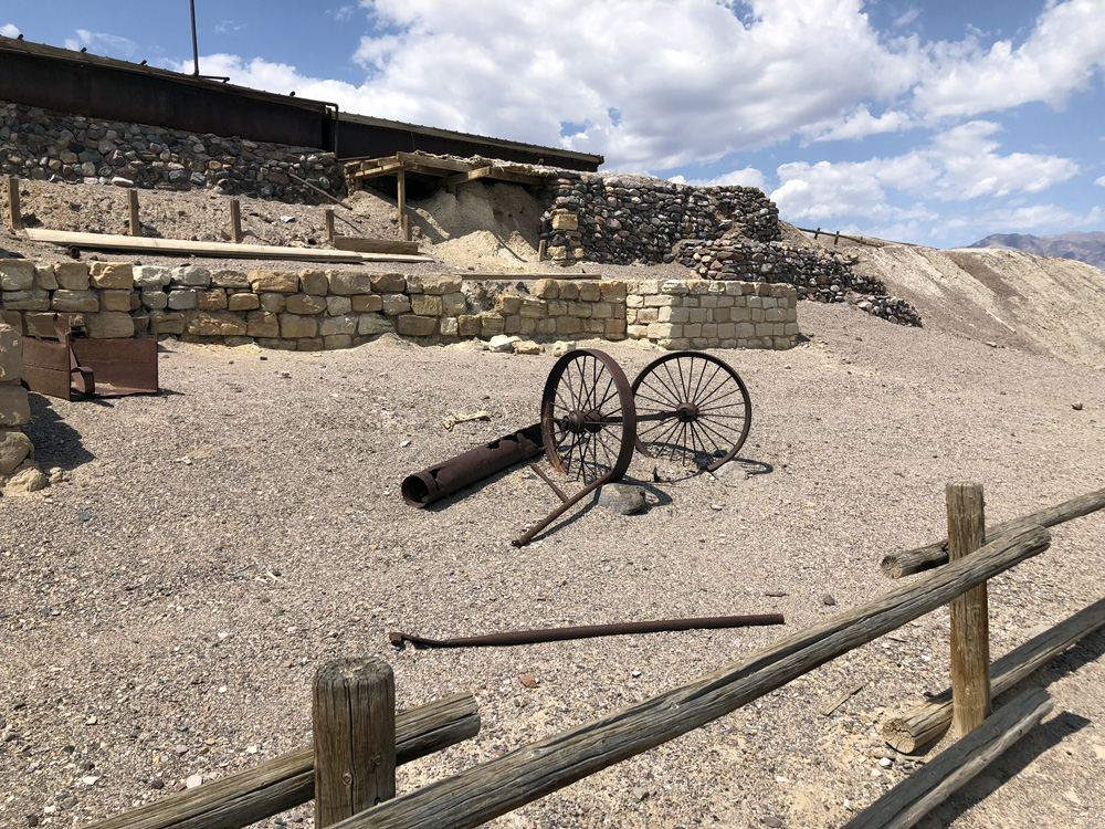 old wagon wheels and closed mine entrance to the borax mine